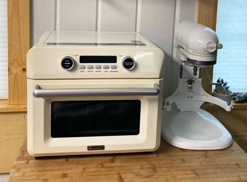 white air fryer oven on counter next to white kitchenaid mixer