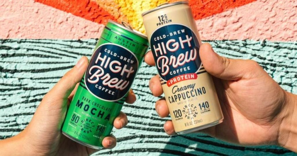 two hands holding High Brew Cold Brew Coffees