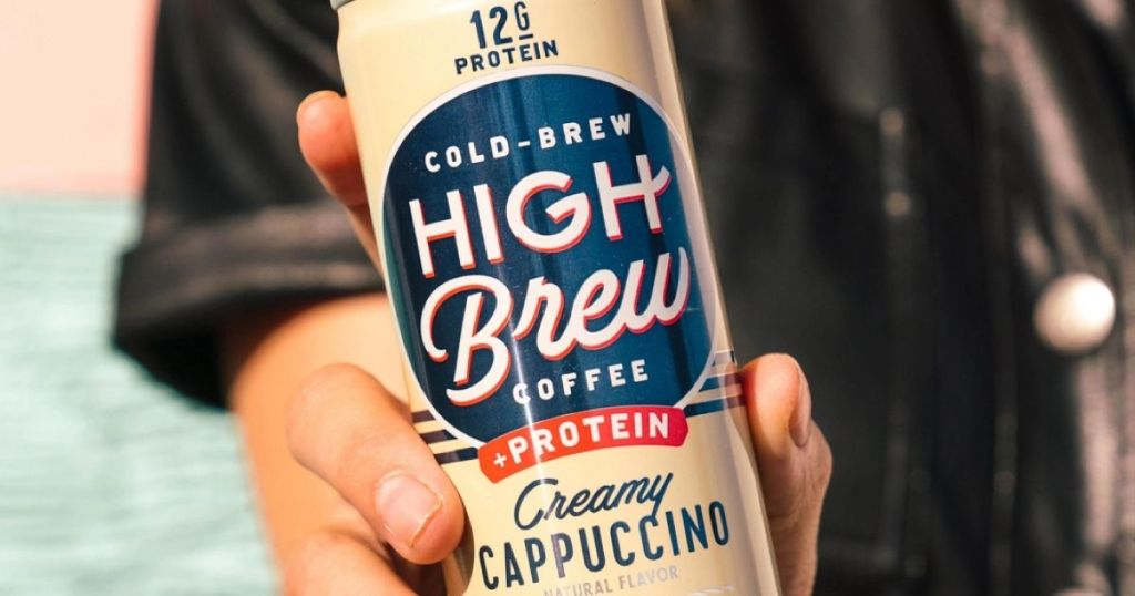 hand holding a can of High Brew + Protein coffee