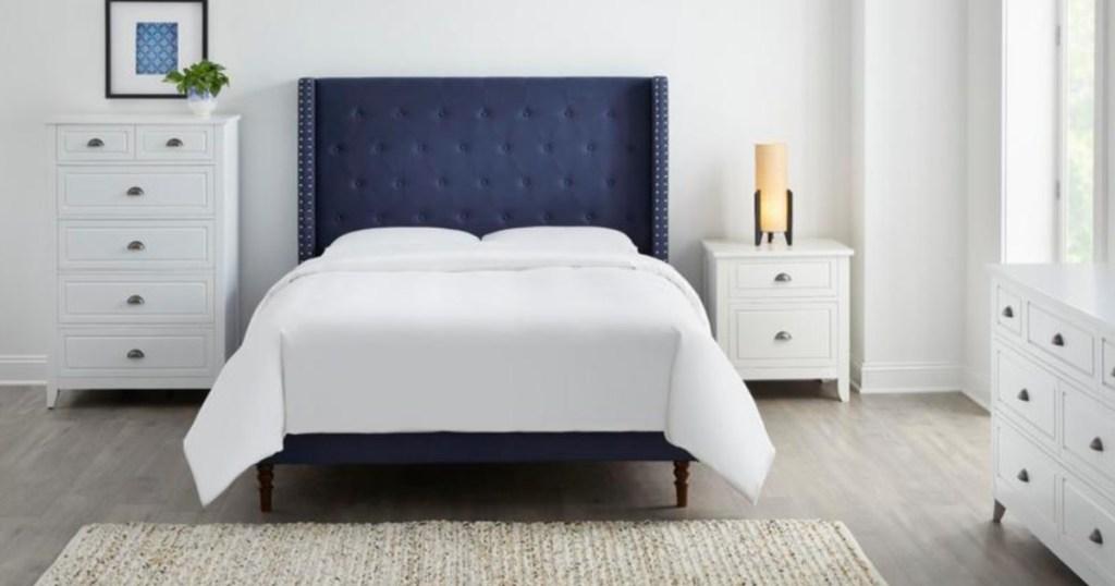 blue upholstered bed