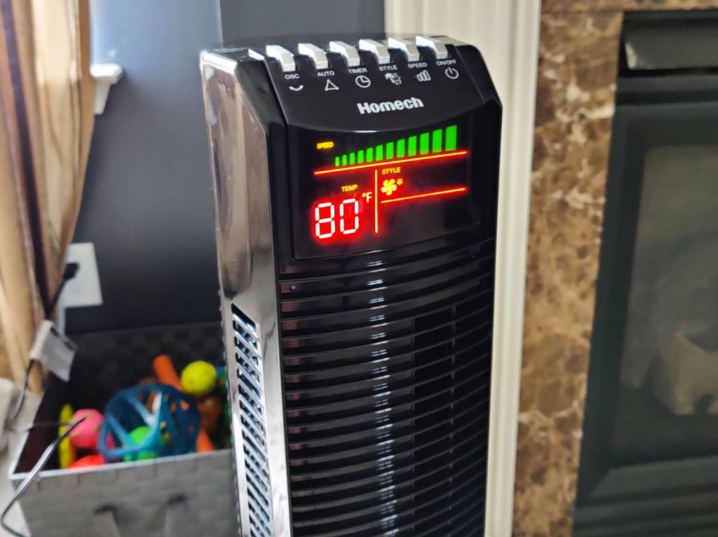 tower fan with led display and control buttons on top