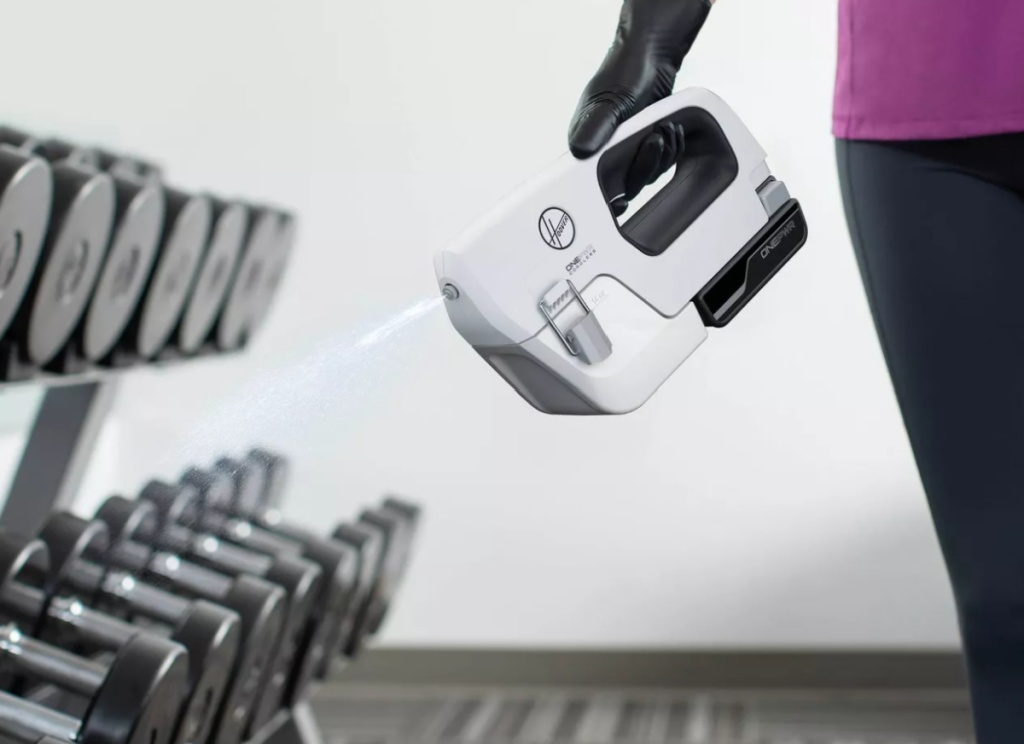 person holding hoover onepwr cleaner