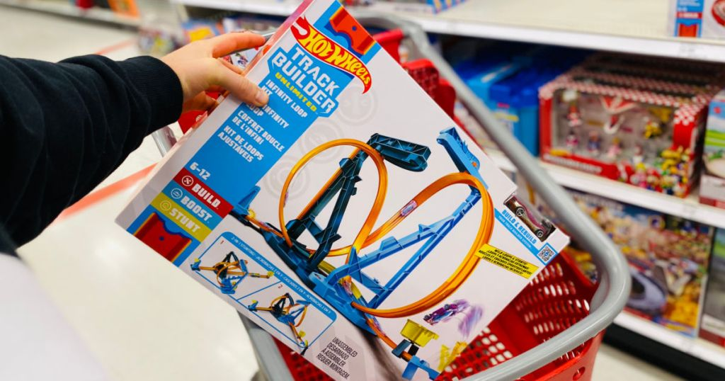 hand holding toy car track set