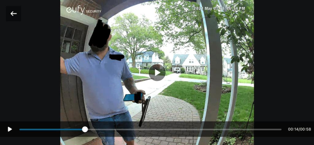 video footage of man standing at front door
