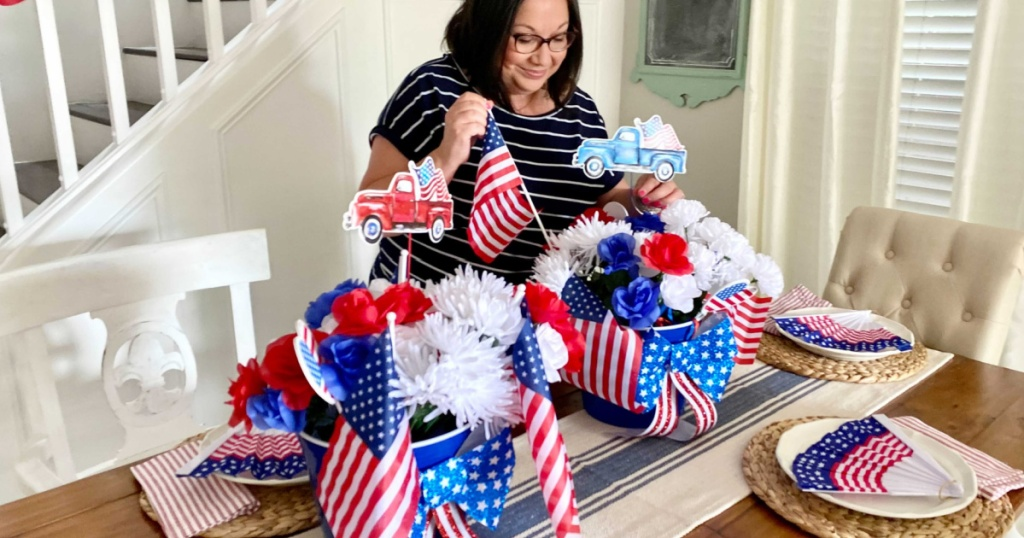 woman decorating with dollar tree party supplies and patriotic decor