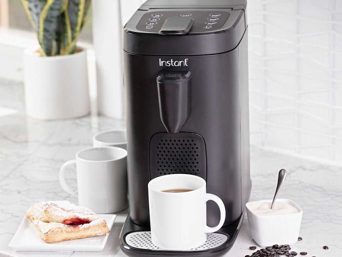 black Instant Pod espresso and coffee maker on counter