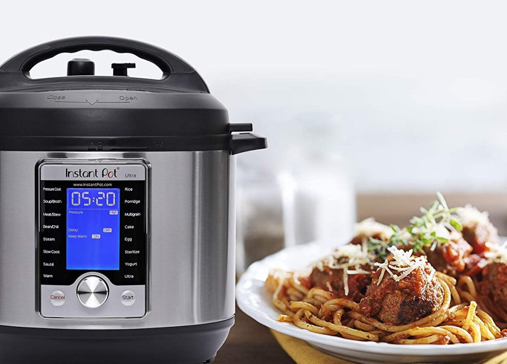 Instant Pot next to plate of spaghetti