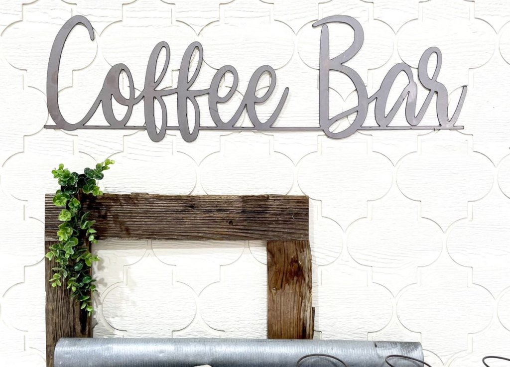 metal sign on wall that says coffee bar