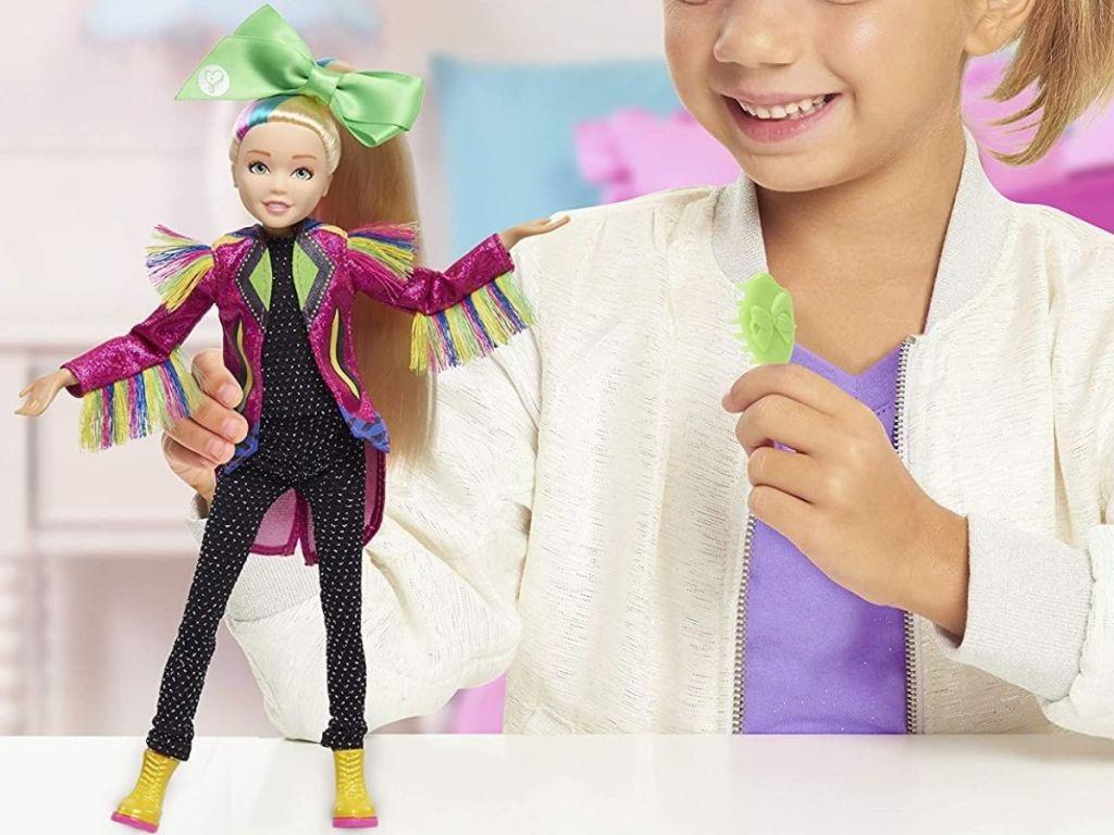 Little girl playing with Jojo Siwa Singing Doll