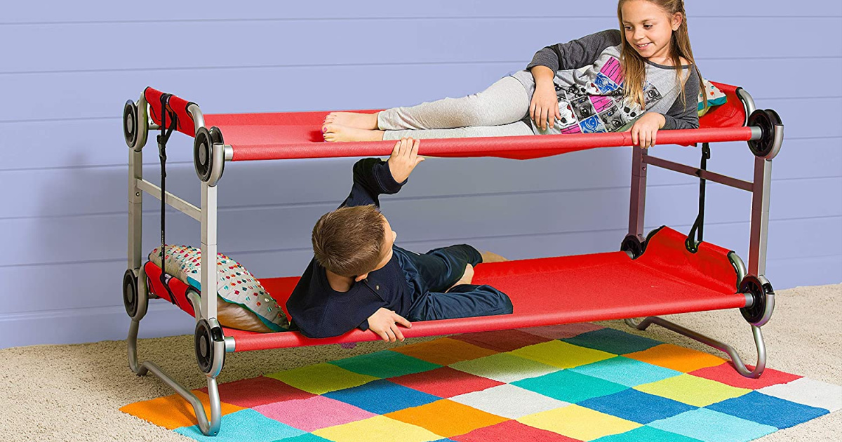 two kids on portable bunk beds