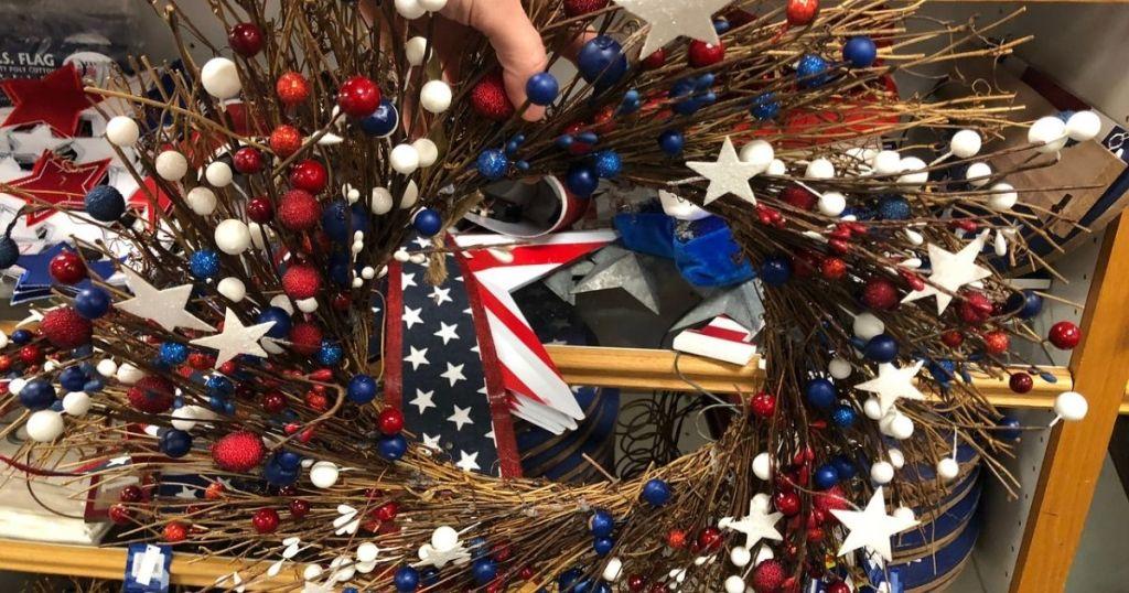 Woman holding patriotic wreath