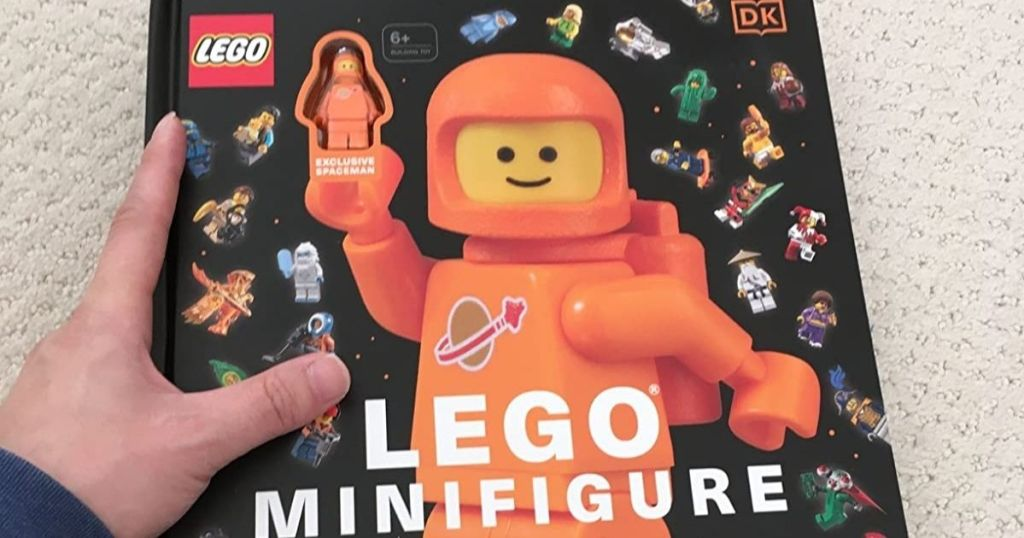 hand holding a LEGO Minifigure Book