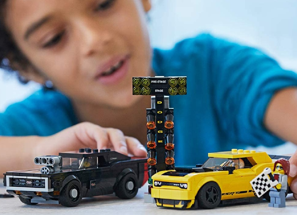 boy playing with lego speed set dodge charger set