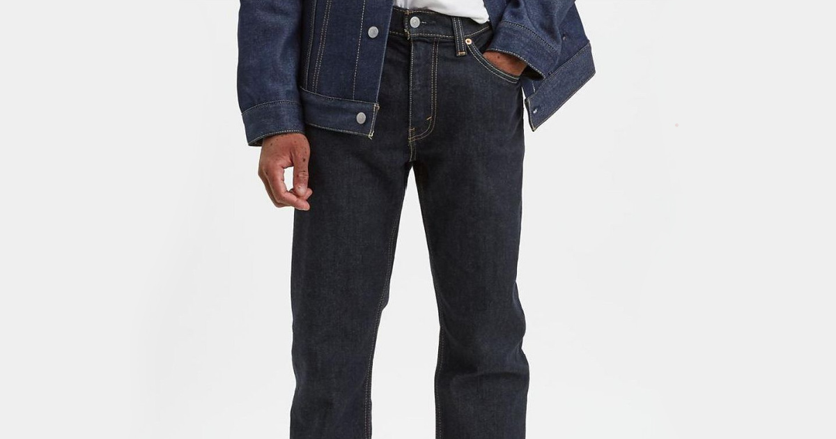 man wearing dark denim jeans