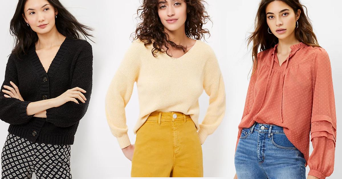 Three women wearing sweaters