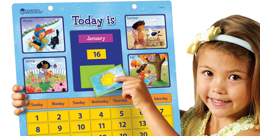 Girl holding Learning Resources Calendar