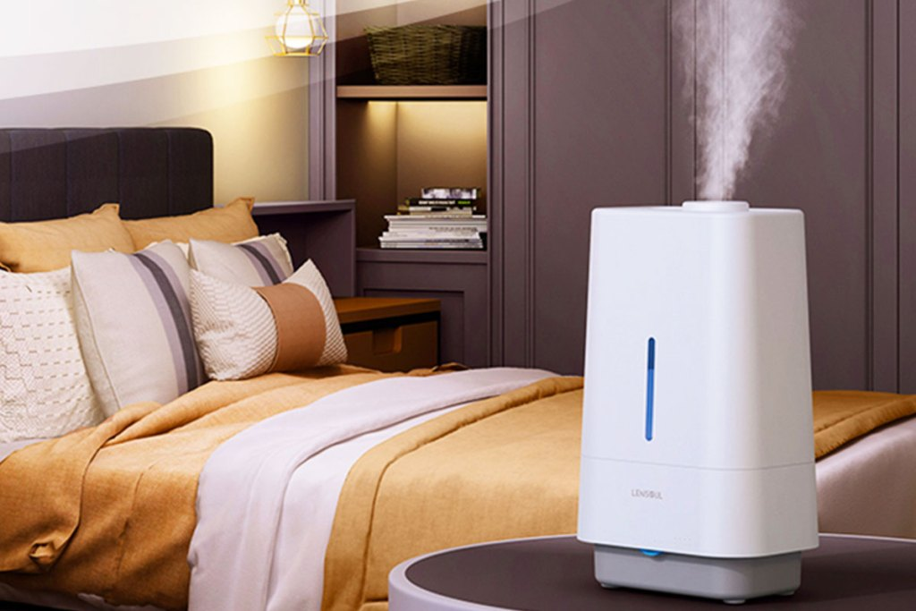 humidifier in bedroom near bed