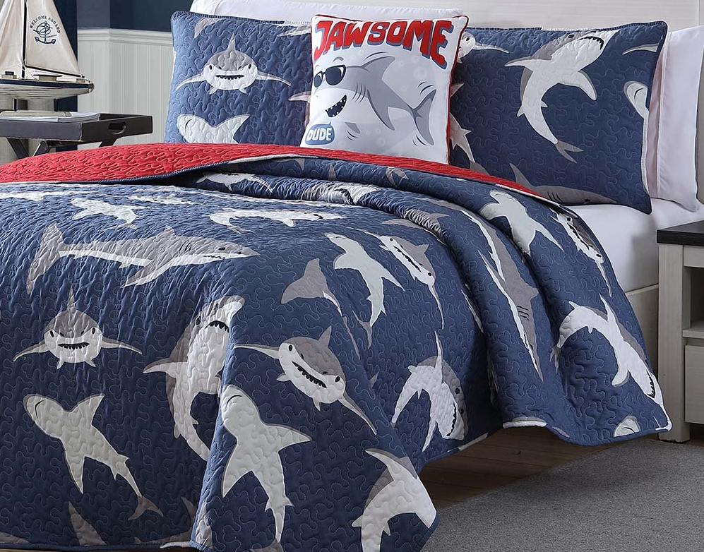 bed with shark blankets on it