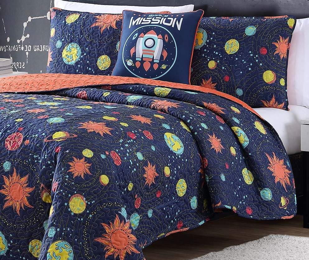 bed with space bedding on it