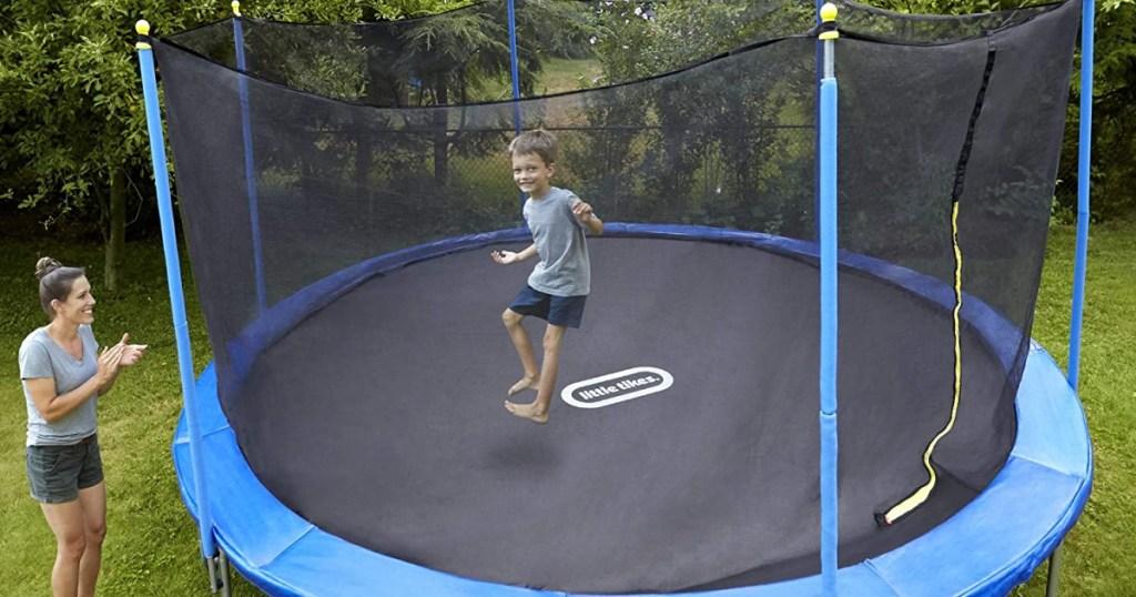 Little Tikes brand trampoline in back yard