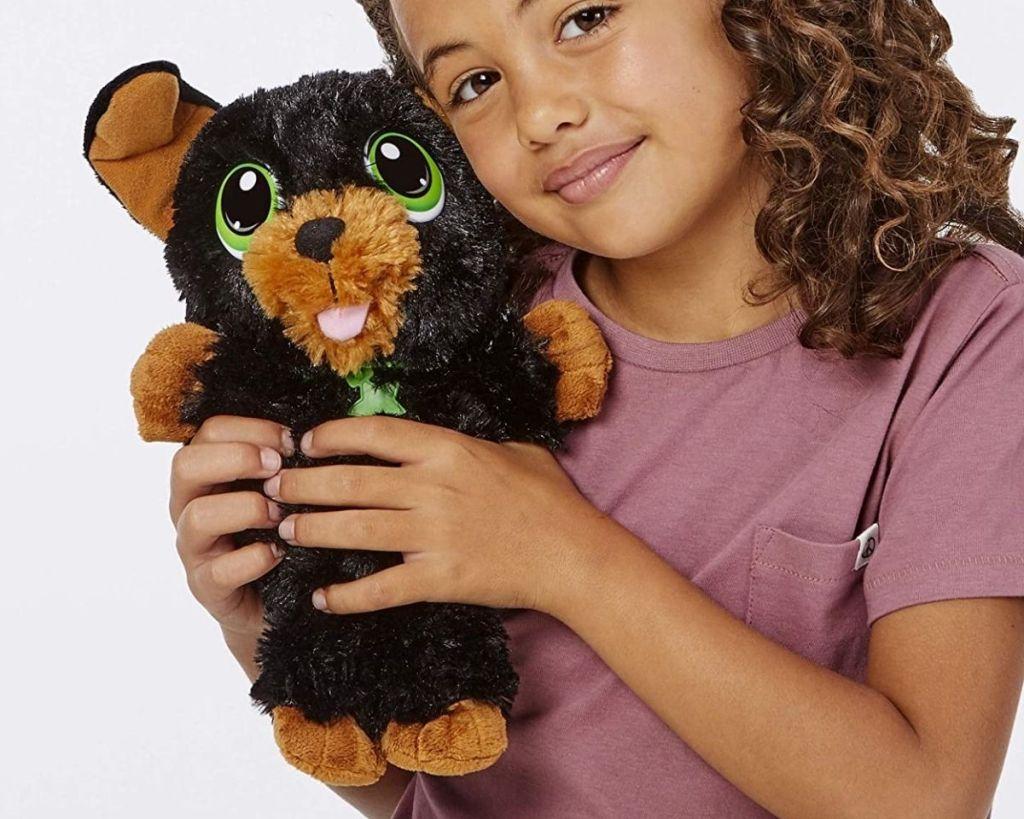 child holding Little Tikes Yorkie Cuddle Pup