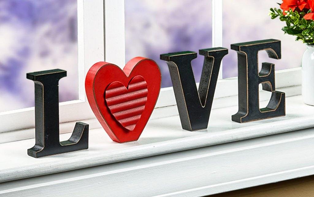 love sign with O letter replaced with a heart