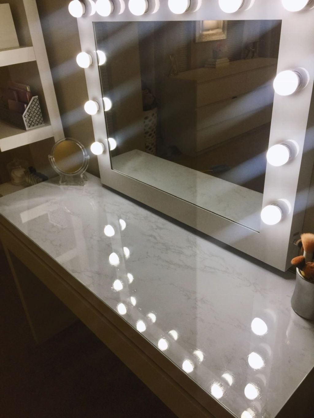vanity with marble paper on it
