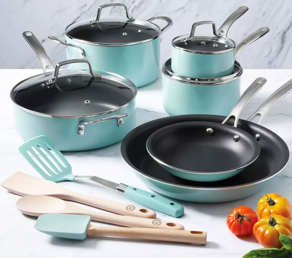 teal colored cookware set with 4 utensils on a kitchen counter