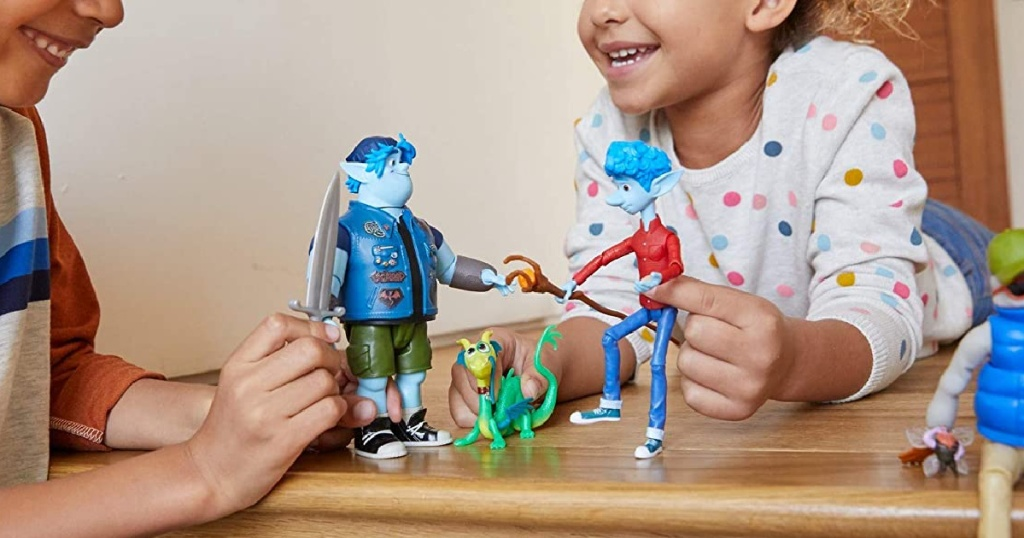 Kids playing with a Disney Pixar themed playset