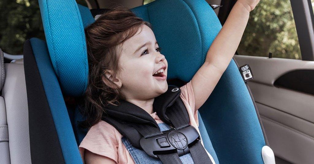 toddler girl in blue car sear