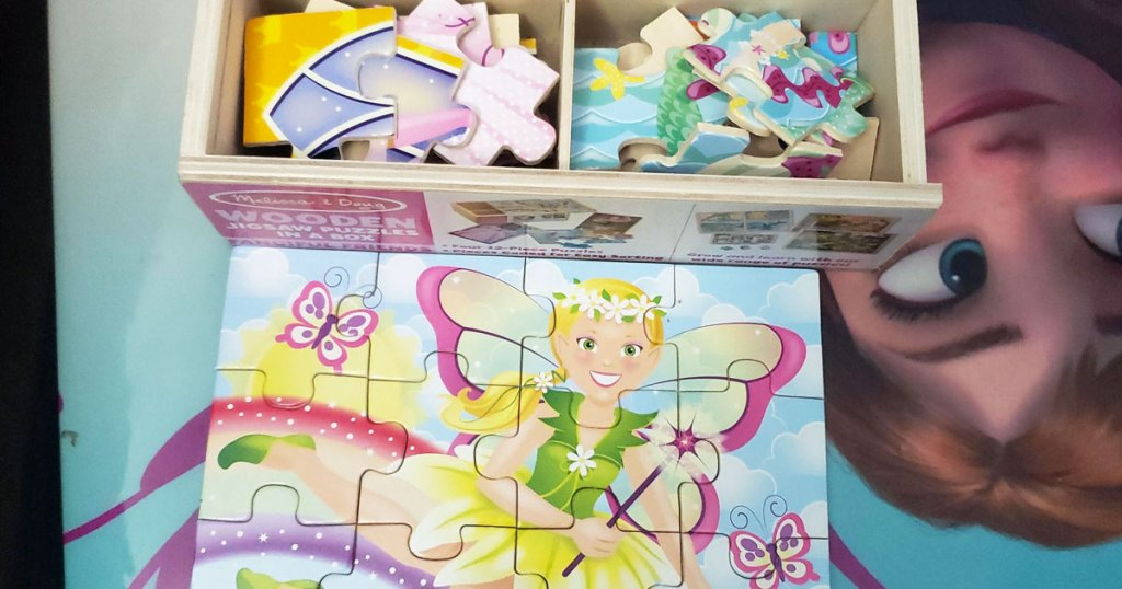 completed fairy puzzle in front of wooden box