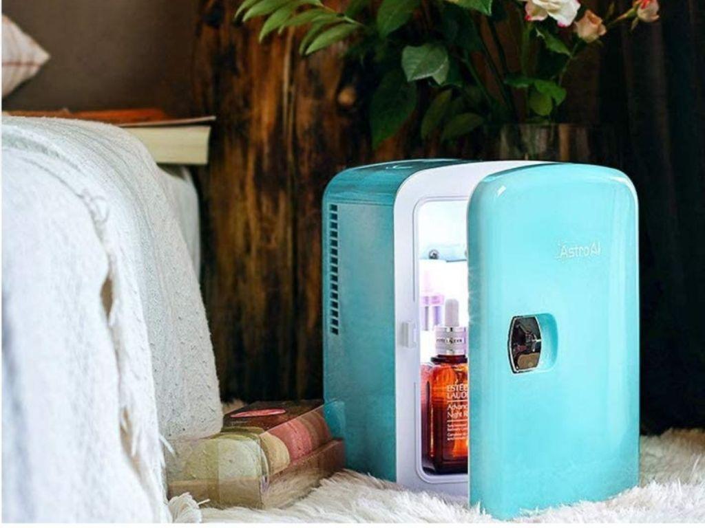 teal mini fridge with door semi-open