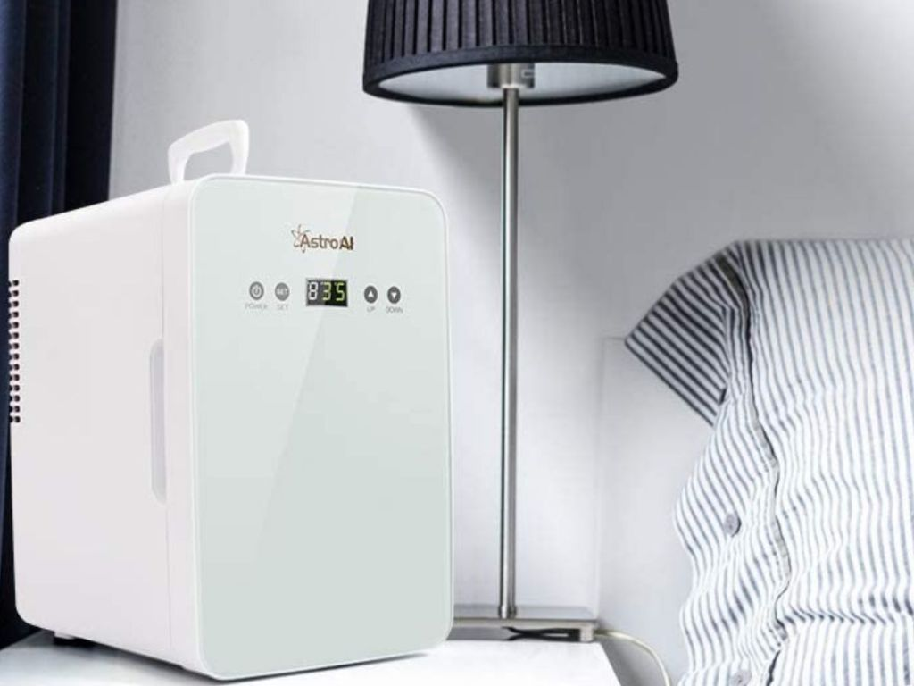 white mini fridge on side table