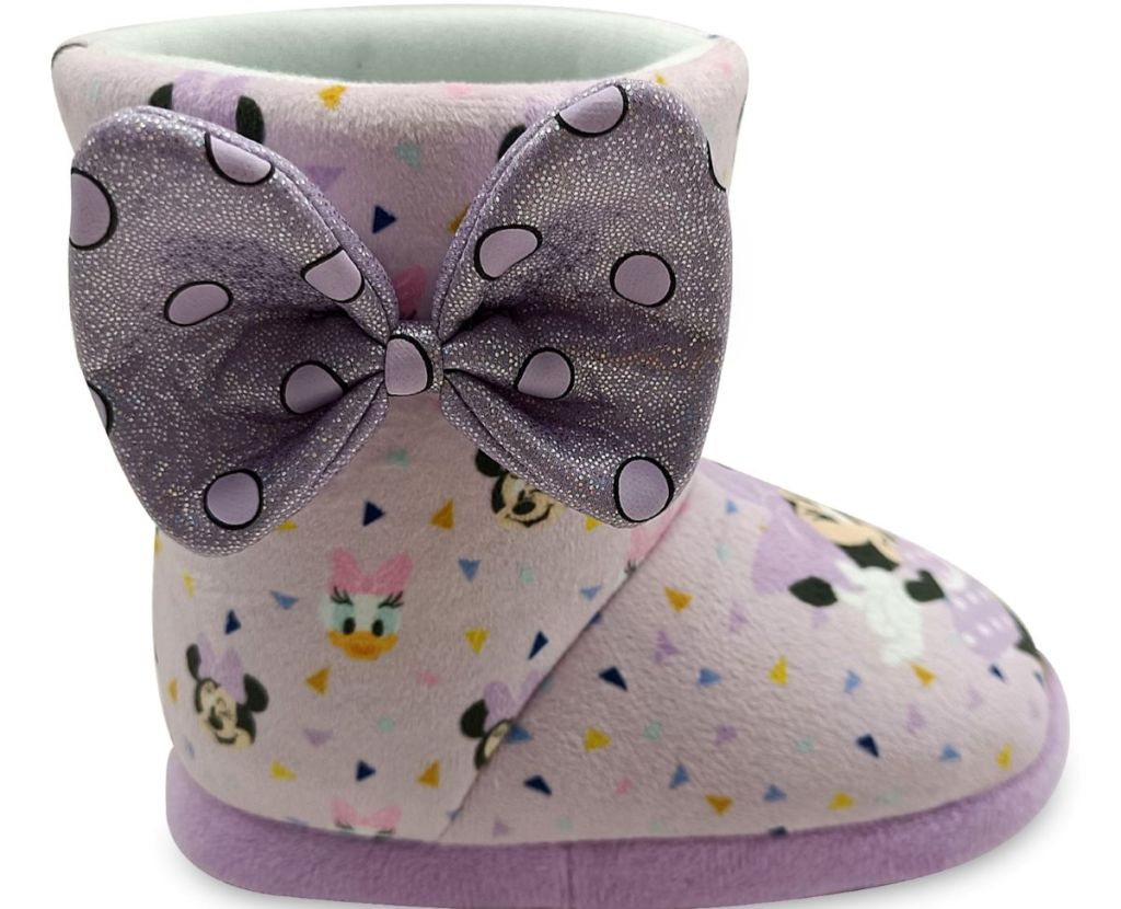 Minnie Mouse slipper with a bow on it