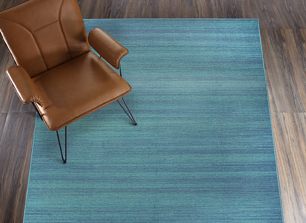 leather chair on a blue area rug