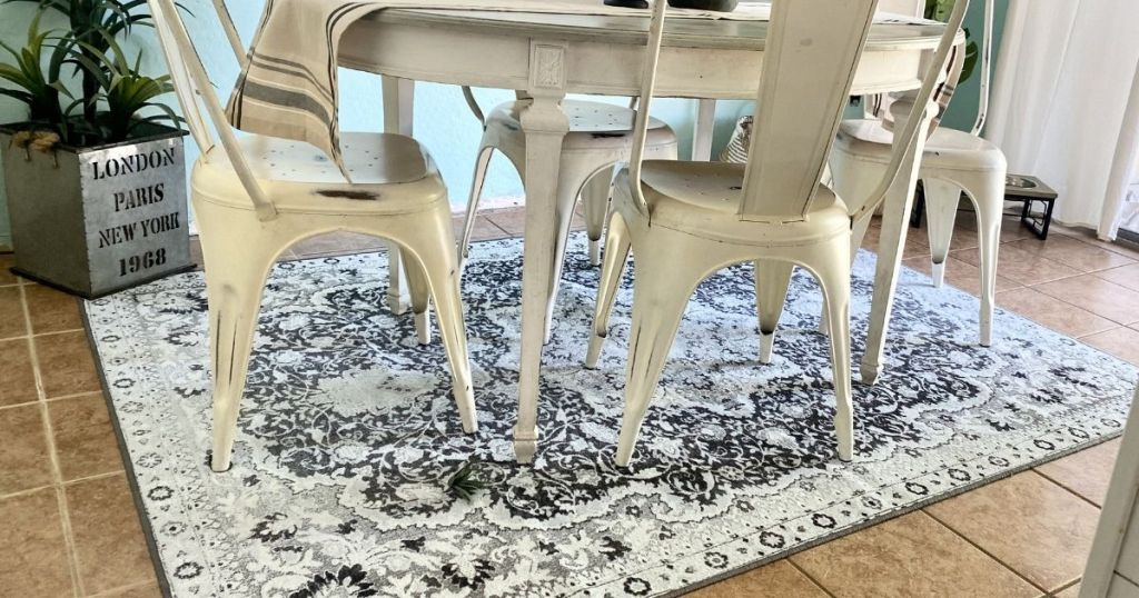 kitchen table with an area rug underneath it
