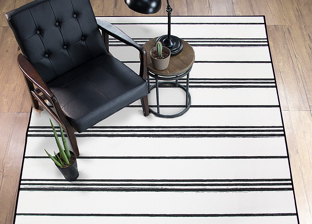 area rug with chair and table on it