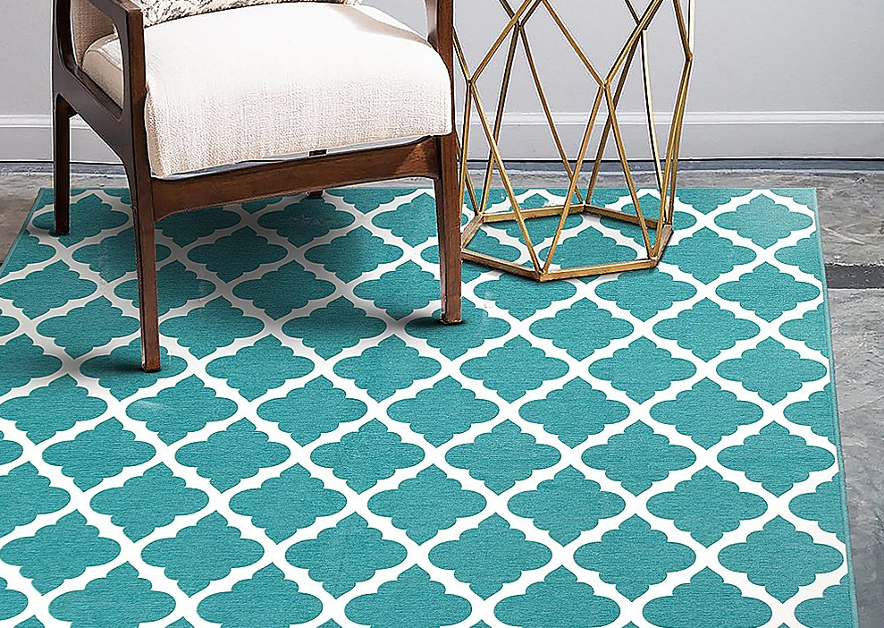 area rug with a chair and table on it