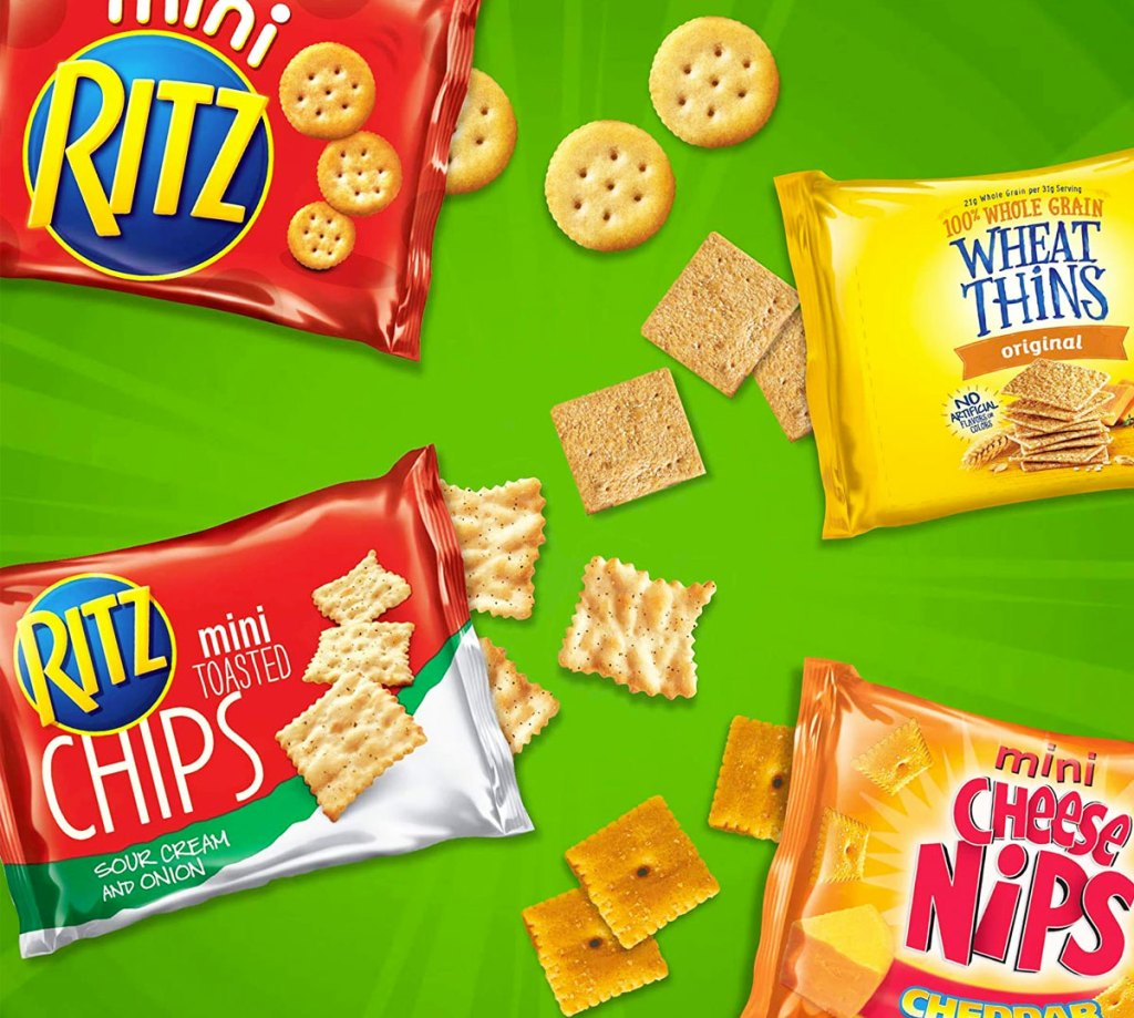 four packs of ritz, wheat thins, and cheese nips crackers
