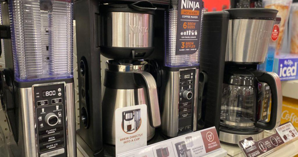 black coffee maker on shelf