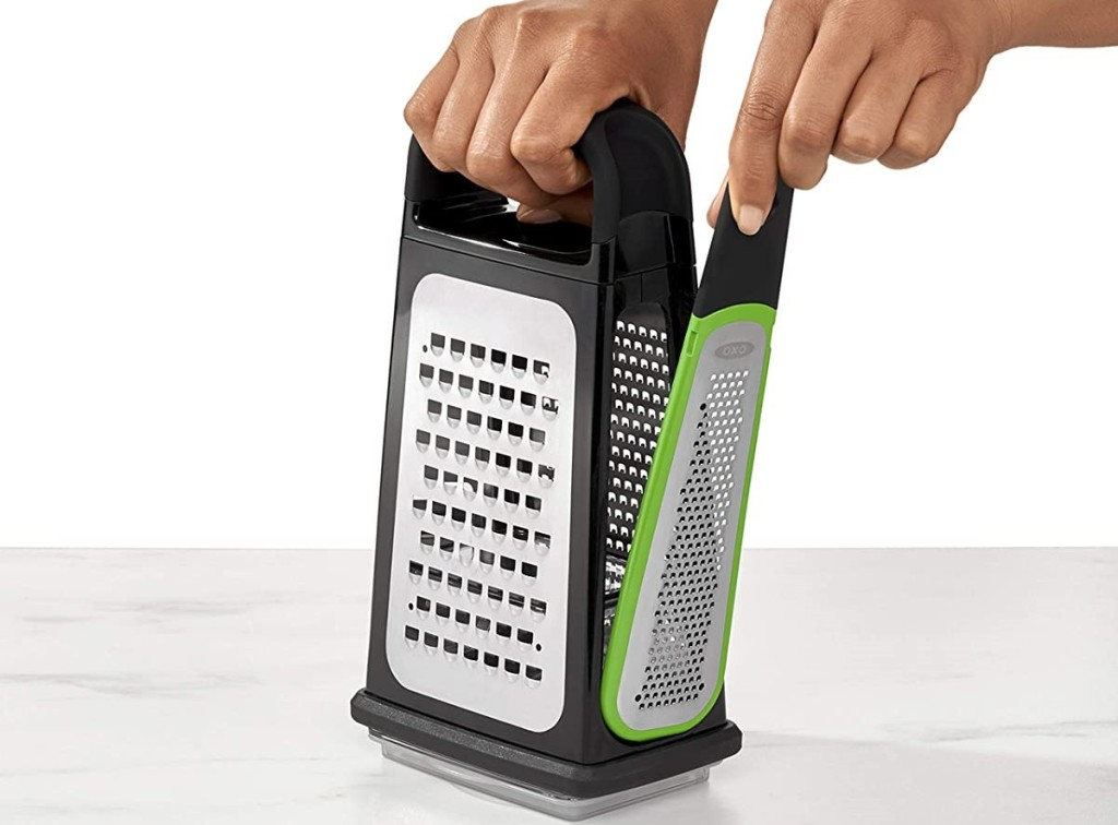 hand holding a zester on the side of a grater