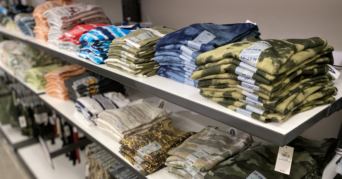 Old Navy boys tees folded on store display shelves