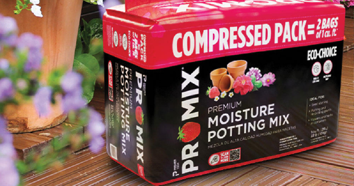 box of potting soil sitting on a deck