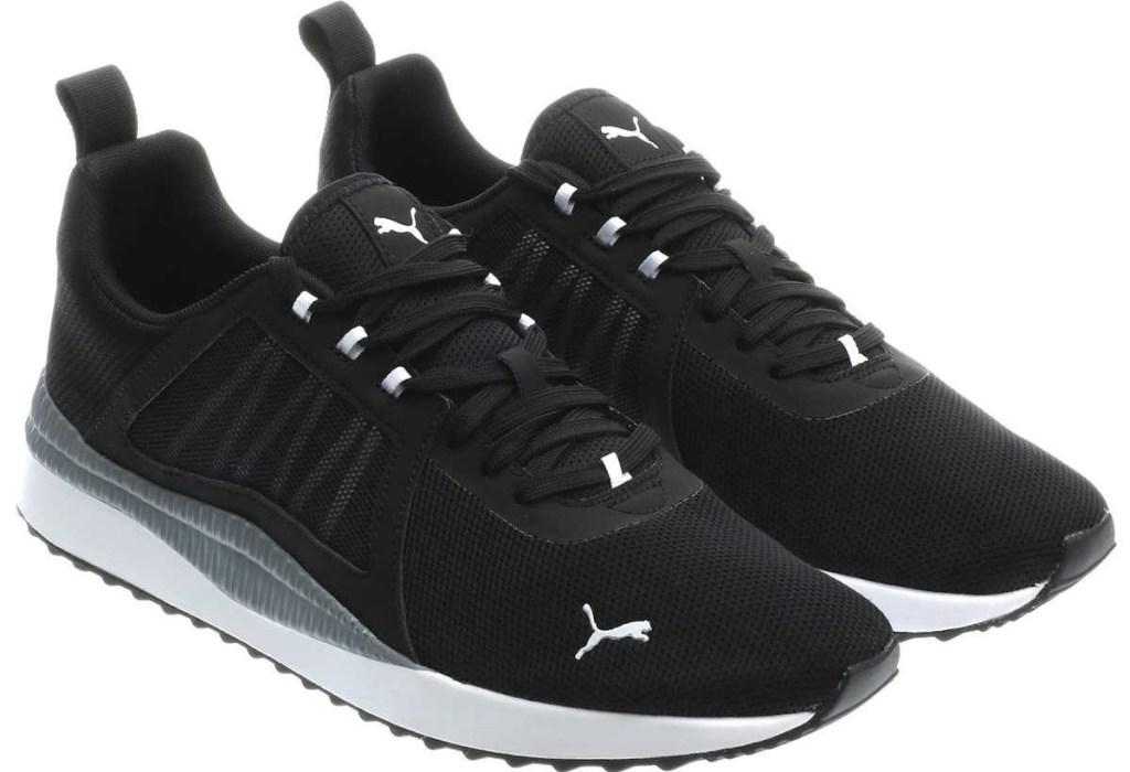 pair of black PUMA sneakers