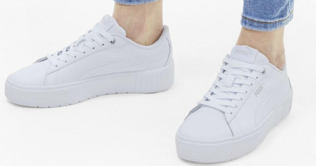 woman wearing white sneakers