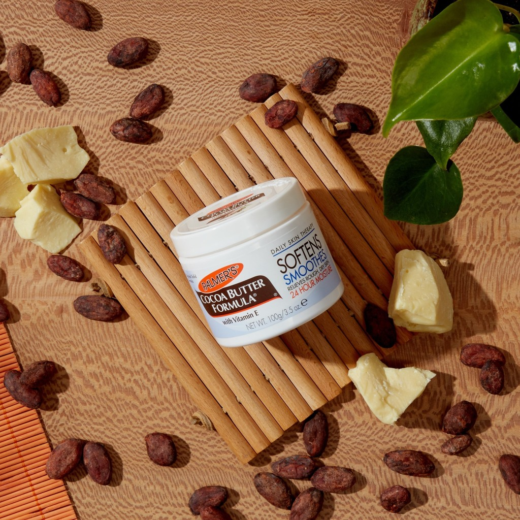 Palmer's Cocoa Butter on tropical background