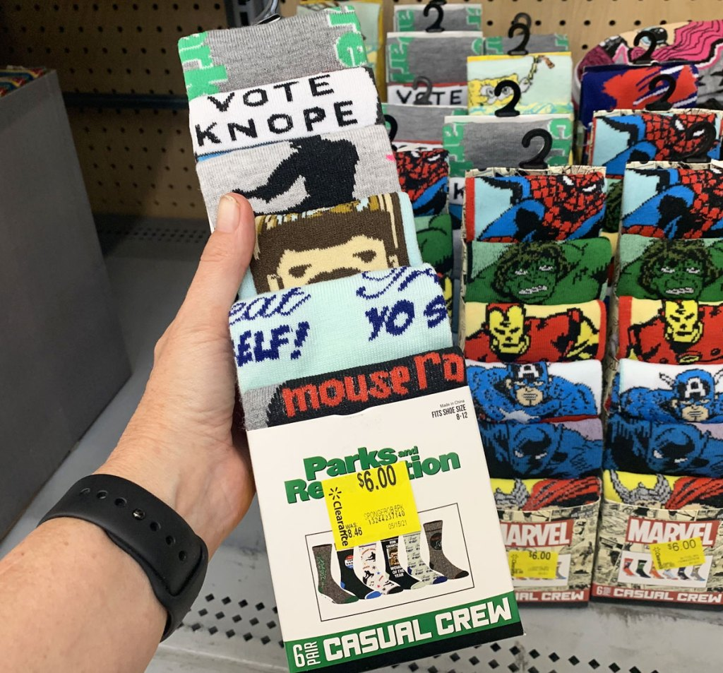 person holding up 6-pack of parks & rec themed socks