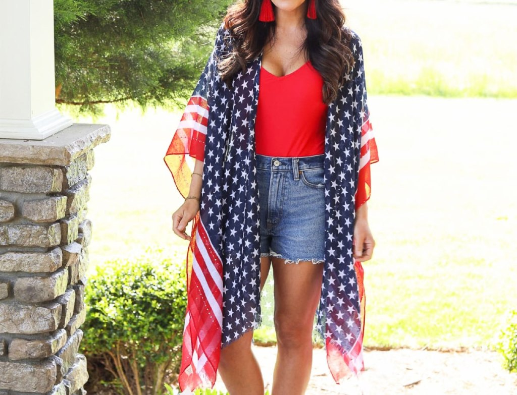 woman in red tank, jean shorts, and patriotic kimono