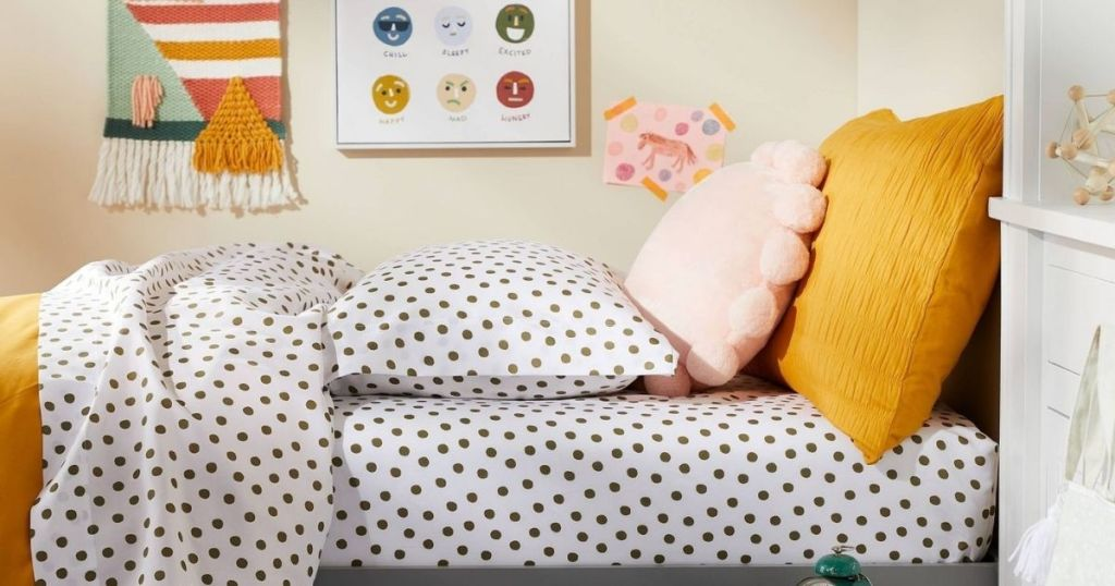 bed with polka dot sheets on it