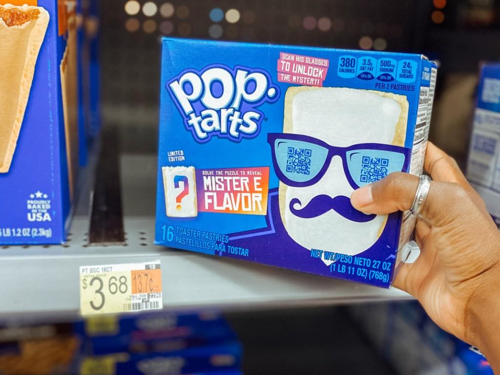 hand pulling box of Pop-Tarts off store shelf